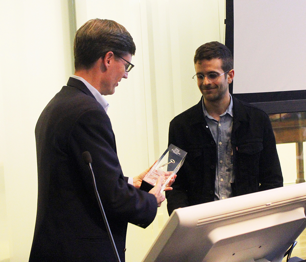 Linneaus receiving the award for Deal of the Year