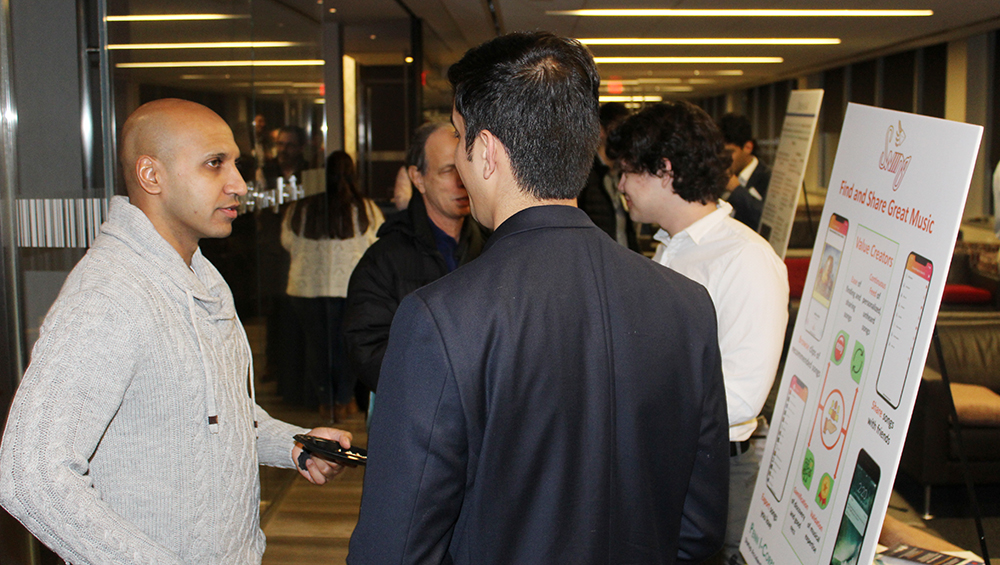 Swiing founders talking with a Celebration of Innovation attendee