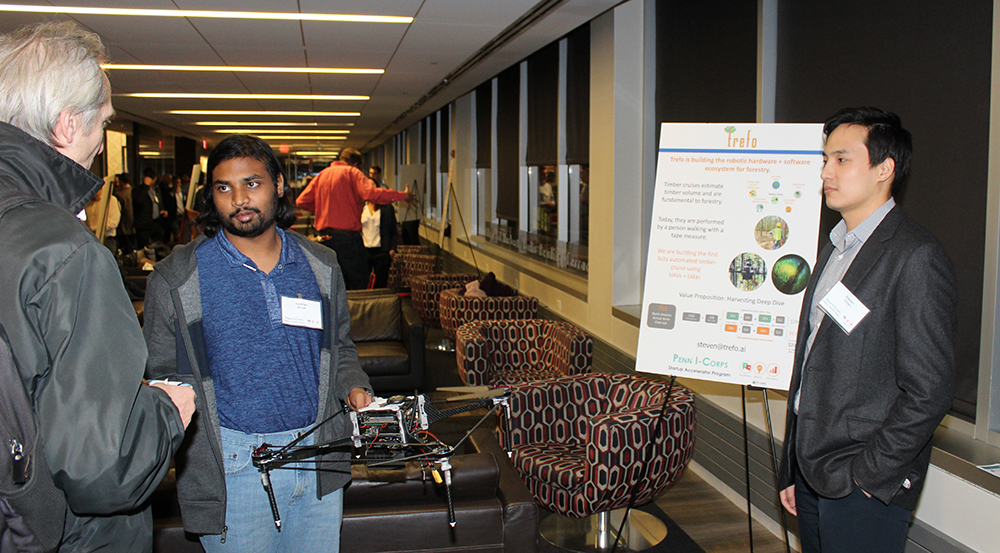 Trefo, an I-Corp program graduate, talking with a Celebration of Innovation attendee