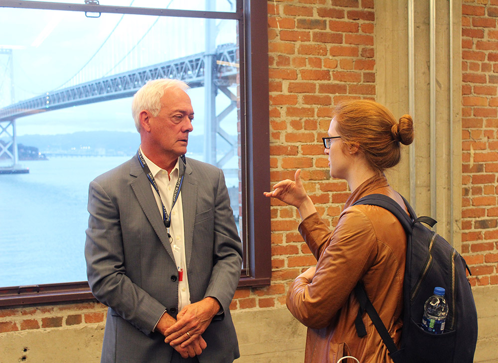Glen N. Gaulton, PhD (Left) talking to event attendee